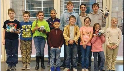 Cotton County 4-H'ers participating in the State 4-H Robotics Contest with their EV3 Lego Robot. Pictured (Left to Right): Front Row: Luke Liming, Jaxon Kelley, Brooke Olbera, Kaizer Gonzalez, Avery Wagner, Kaydee Britt, Rory Schroeder Hill, Gracelynn Williams. Back Row: Adien Spence, Zachary Wagner, Luke Liming, and Preston Fremin.